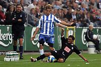 Fotball<br /> UEFA Cup<br /> Foto: Polfoto/Digitalsport<br /> NORWAY ONLY<br /> <br /> OBs Tobias Grahn runder Hertha Berlins Sofian Chahed, da OB torsdag eftermiddag tog imod Hertha Berlin i returkampen i første runde af UEFA-Cuppen, det første opgør i Berlin endte 2-2.