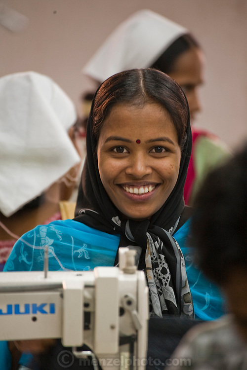 Ruma Akhter, 20, who works as a seamstress for the Ananta Garment Company in Dhaka.(Featured in the book What I Eat: Around the World in 80 Diets.) MODEL RELEASED.