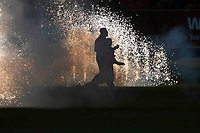 Rugby Union - 2017 / 2018 European Rugby Champions Cup: Scarlets vs. RC Toulonnaise<br /> <br /> scarlets & mascot take the field silhouetted by fireworks, at Parc y Scarlets, Llanelli.<br /> <br /> COLORSPORT/WINSTON BYNORTH