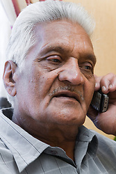 Older man chatting on the telephone,