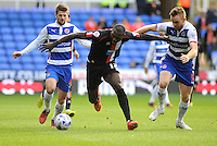 Blackpool's Ishmael Miller under pressure from Reading's Alex Pearce (right) and Oliver Norwood<br /> <br /> Photographer Kevin Barnes/CameraSport<br /> <br /> Football - The Football League Sky Bet Championship - Reading v Blackpool - Saturday 25th October 2014 - Madejski Stadium - Reading <br /> <br /> © CameraSport - 43 Linden Ave. Countesthorpe. Leicester. England. LE8 5PG - Tel: +44 (0) 116 277 4147 - admin@camerasport.com - www.camerasport.com