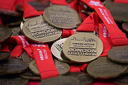 © Licensed to London News Pictures. 27/07/2013. London, UK. Pile of medals at the London Triathlon 2013 at the ExCel centre in Royal Victoria Dock in East London. Photo credit : Vickie Flores/LNP