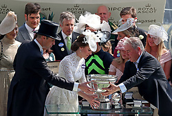 The Duke and Duchess of Cambridge present the trophy for winning King's Stand Stakes to trainer Wesley Ward during day one of Royal Ascot at Ascot Racecourse.