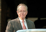 Kenneth Starr, the independent prosecutor investigating President Clinton's affair with former White House intern Monica Lewinsky gets into his car August 4, 1998 at his home in McClean, VA. Starr has agreed to grant immunity to Lewinsky in return for her cooperation in the investigation.