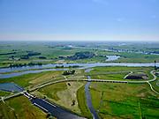 """Nederland, Overijssel, Gemeente Kampen; 21–06-2020; het Reevediep richting IJssel, gezien vanaf de monding van het Reevediep in het Revemeer (voorheen Drontermeer).<br /> Het Reevediep is aangelegd in het kader van het project Ruimte voor de Rivier om bij hoogwater water af te voeren voordat dit het nabij gelegen Kampen bereikt, direct naar het IJsselmeer, de 'bypass Kampen'. Het Reevediepgebied is ook een natuurgebied en vormt een ecologische verbindingszone tussen rivier de IJssel en Drontermeer.<br /> Reevediep in the direction of river IJssel, seen from the mouth of the Reevediep.<br /> The Reevediep has been constructed as part of the Room for the River project, and functions to discharge high waters before reaching the nearby Kampen, directly to the IJsselmeer, the """"bypass Kampen"""". The Reevediep area is also a nature reserve and forms an ecological connecting zone between the river IJssel and Drontermeer.<br /> <br /> luchtfoto (toeslag op standard tarieven);<br /> aerial photo (additional fee required)<br /> copyright © 2020 foto/photo Siebe Swart"""