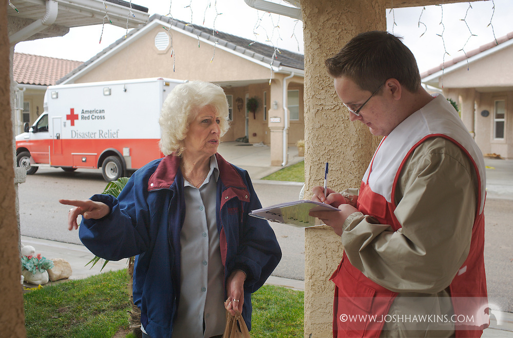 Red Cross disaster assessment teams in Beaver Dam, AZ on December 23rd, 2010 after the flooding the occurred over the previous days...Lois Rolfsmeyer talks to Red Cross worker Christian Raymer on Humphrey Bogart about the damage at her house and suffered by surrounding homes.