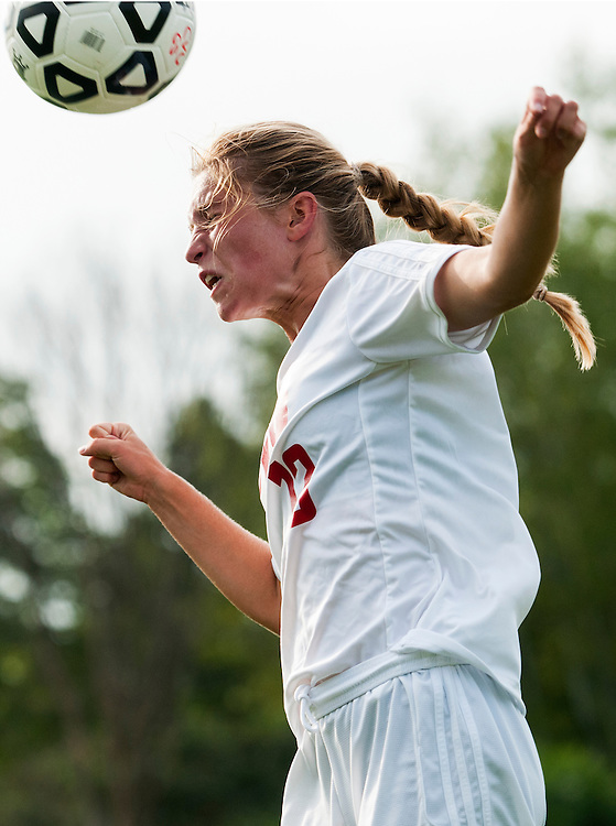 CVU's Abba Weimer (10) heads the ball during the girls varsity soccer game between the Burlington Seahorses and the Champlain Valley Union Redhawks at CVU High School on Tuesday afternoon September 8, 2015 in Hinesburg. (BRIAN JENKINS/for the FREE PRESS)