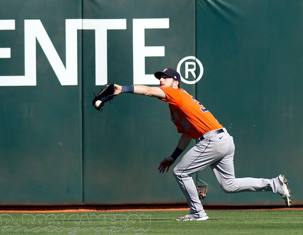 Sep 26, 2021; Oakland, California, USA; Houston Astros right fielder Kyle Tucker (30) makes the catch of a deep fly ball by Oakland Athletics right fielder Seth Brown in the seventh inning at RingCentral Coliseum. Mandatory Credit: D. Ross Cameron-USA TODAY Sports
