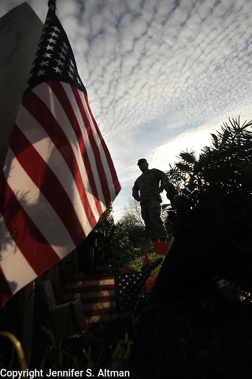 """Col. Tom Klodnitz, who taught several of the West Point cadets killed in Iraq, is seen at the cemetery where they are buried, in West Point, New York, USA. There were 4,400-plus men and women who did not return from Iraq. The are 19 U.S. Military Academy graduates killed in Iraq who are buried in historic West Point Cemetery, including Lt Emily Perez, the first member of West Point's """"Class of 9/11"""" to die in combat, the first female West Point graduate to die in Iraq and the highest-ranking black and Hispanic woman cadet in the academy's history.  12/9/2011 Photo by Jennifer S. Altman, Freelance"""