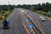 Works by Highways England to convert the M4 into a smart motorway are pictured during a weekend closure between Junctions 5 and 6 on 20th June 2021 in Datchet, United Kingdom. All lane running motorways, including those such as the M4 currently under construction, will require radar technology to detect stopped cars.