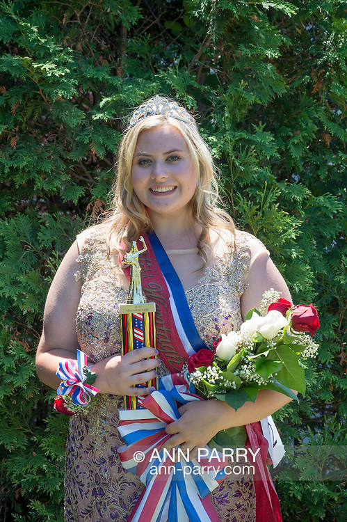 Wantagh, New York, USA. July 4, 2016. EMMA CAREY, wearing crown and holding trophy and bouquet of roses, is crowned Miss Wantagh 2016 at the 60th Annual Miss Wantagh Pageant, an Independence Day tradition on Long Island. Since 1956, the Miss Wantagh Pageant, which is not a beauty pageant, crowns an area high school student based mainly on academic excellence and community service.
