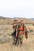 Using a game sled, successful backcountry hunters drag a nice mule deer buck out of the hills east of Dillon, Montana.