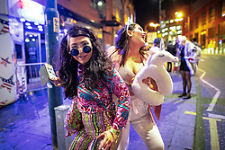 © Licensed to London News Pictures . 27/10/2018. Manchester, UK. Revellers on a night out , many in fancy dress , outside the Printworks in Manchester City Centre , on the weekend before Halloween . Photo credit: Joel Goodman/LNP