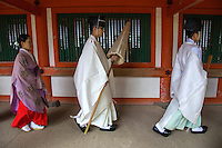 "Kasuga Shrine Shinto Priests -Kasuga-taisha is a Shinto shrine in Nara often called Kasuga Grand Shrine. Established in 768 AD and rebuilt several times over the centuries. Kasuga Taisha is famous for its lanterns that have been donated by worshipers: hundreds of bronze lanterns are hanging from the buildings, and many stone lanterns line the approach to the shrine grounds. The lanterns are lit twice a year at the Lantern Festivals in February and August. Kasuga Shrine, and the Kasugayama Primeval Forest behind it are registered as UNESCO World Heritage Sites which is part of the ""Historic Monuments of Ancient Nara""."