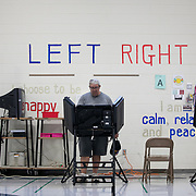 CHARLOTTE, NC - SEPTEMBER 10: Darwin Blaine casts a vote at Precinct #008 at Myers Park Traditional Elementary School in the Mecklenburg County portion of District 9 in Charlotte, NC on Tuesday September 10, 2019. (Photo by Logan Cyrus /The New York Times)