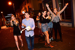 © London News Pictures. 01/01/2017. Aberystwyth, UK.  A group of young revellers out celebrating the 2017 New Year in Aberystwyth, Wales, UK on January 01, 2017 in the early hours of the morning. Photo credit: Keith Morris/LNP