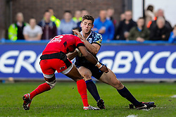 Cardiff Outside Centre (#13) Gavin Evans is tackled heavily by Toulon Full Back (#15) Delon Armitage leading to him being stretchered off during the first half of the match - Photo mandatory by-line: Rogan Thomson/JMP - Tel: Mobile: 07966 386802 21/10/2012 - SPORT - RUGBY - Cardiff Arms Park - Cardiff. Cardiff Blues v Toulon (RC Toulonnais) - Heineken Cup Round 2