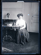 sitting adult woman posing for a portrait France ca 1920s