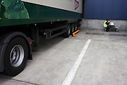 An HGV driver awaits his lorry to be loaded at Sainsbury's 700,000 sq ft (57,500sq m) supermarket distribution depot