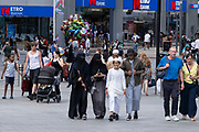 People out and about happily in the city centre shopping district in what was a positive atmosphere on the long awaited freedom day when all remaining coronavirus restrictions are lifted in the UK on 19th July 2021 in Birmingham, United Kingdom. While many people are wearing face masks, they are no longer mandatory, while government advice suggests that it is advised to wear a face covering in busy public places inside and on transport.