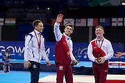 Mcc0055084 . Daily Telegraph<br /> <br /> England's Max Whitlock winning Gold in the Men's Individual Artistic Gymnastics on Day 7 of the 2014 Commonwealth Games with his team mate Nile Wilson winning Bronze . Scotland's Daniel Keatings won the Silver .<br /> <br /> 30 July 2014