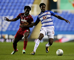 Reading's Tyler Blackett in action with Swansea's Wilfried Bony (left) during the Carabao Cup, third round match at the Madejski Stadium, Reading.