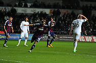 Stoke city's Michael Owen (c) celebrates after he scores his sides only goal as they lose 3-1. The goal is Owen's 1st goal for Stoke city and his 150th Premier league goal. Barclays premier league, Swansea city v Stoke city at the Liberty Stadium in Swansea on Saturday 19th Jan 2013. pic by Andrew Orchard, Andrew Orchard sports photography,