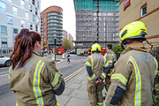 London, Britain, May 7, 2021 — Firefighters tackled a blaze in a 19-storey block of flats in east London on Friday, May 7, 2021. (Photo/ Vudi Xhymshiti)