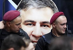 May 30, 2017 - Kiev, Ukraine - Ukrainian policemen stand in front of a photo of former governor of the Ukrainian Odessa region and former Georgian president MIKHEIL SAAKASHVILI (C) during a meeting and a rally of his party the ''The movement of new strengths'' in front of the Justice Ministry in Kiev, Ukraine, on 30 May 2017. Activists gathered to demand registration of MIKHEIL SAAKASHVILI political party ''The movement of new strengths'' and dismiss registration of the fake party with the same name reading like ''The block of Mikhail Saakashvili'', which was allegedly registered by Oleg Sushko, according to local media reports. (Credit Image: © Serg Glovny via ZUMA Wire)