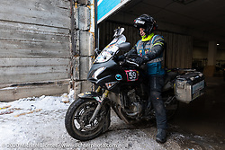 Alessandro Ciceri, known for his cold weather riding and as Wizz on social media (@wizz_inwiaggio), after riding 6,200 mile (10,000 km) from his home in Italy in the middle of winter and after racing on the mile long ice track. Here he is just before leaving to ride another 3,100 miles (5,000 Km) through Siberia in winter to Vladivostok after the Baikal Mile Ice Speed Festival. Maksimiha, Siberia, Russia. Monday, March 2, 2020. Photography ©2020 Michael Lichter.