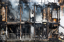 © Licensed to London News Pictures. 09/09/2019. London, UK. Damage is seen at a four-storey block of flats in Worcester Park, south-west London, where twenty fire engines and more than 100 firefighters were called overnight. The fire quickly spread at around 1.30am on Monday morning on Sherbrooke Way. No casualties are reported. Photo credit: Peter Macdiarmid/LNP