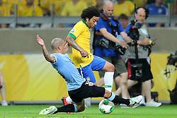 Marcelo em lance da partida entre Brasil e Uruguai válida pela Copa das Confederações, no Estádio Mineirão, em Belo Horizonte-MG. FOTO: Jefferson Bernardes/Preview.com