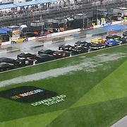 A red flag due to rain causes a delay during the 56th Annual NASCAR Daytona 500 practice session at Daytona International Speedway on Saturday, February 22, 2014 in Daytona Beach, Florida.  (AP Photo/Alex Menendez)