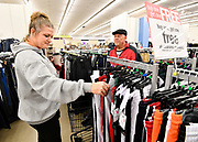 Michelle Kruse and her fiancé Don Gunter, both of Highland, inside the Gordman's store in Fairview Heights. They were looking for pants and boots for children, and were shopping for six. Shoppers looking for bargains and discounted items endured a light but steady rain on Thanksgiving Day as they waited for stores to open in Fairview Heights, IL on November 28, 2019.<br />  Photo by Tim Vizer