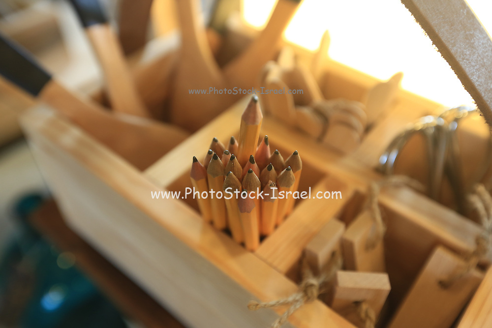 Pencils in a wooden box