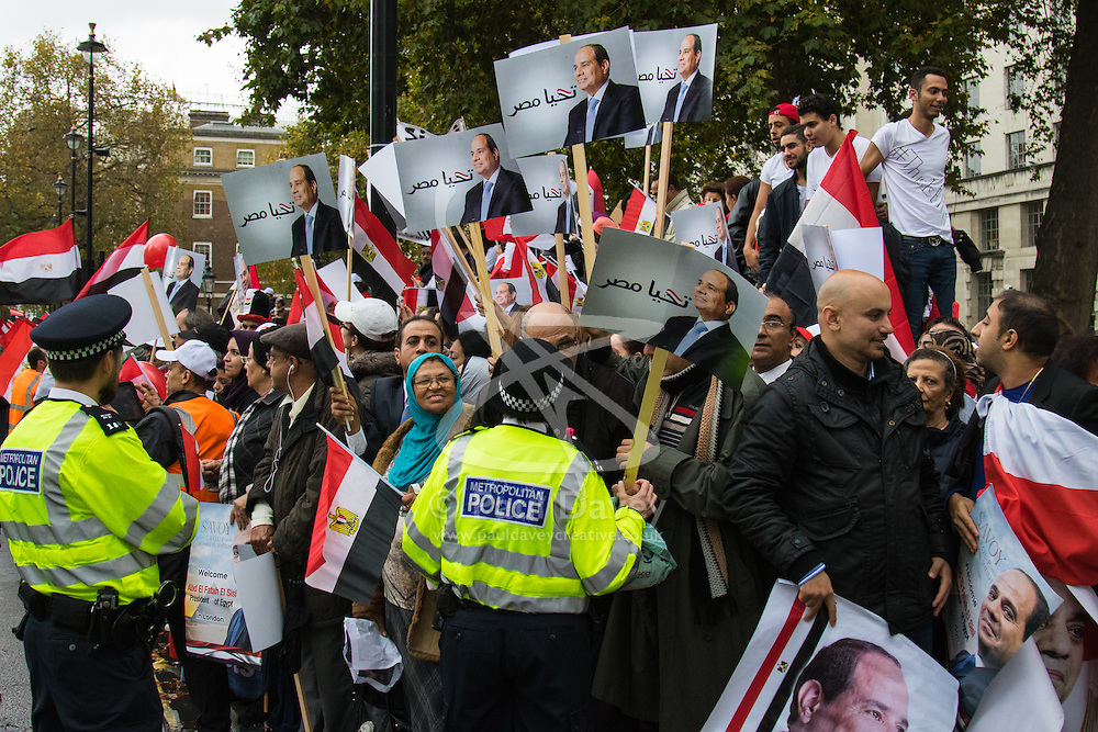 Whitehall, London, November 5th 2015. UK Egyptians demonstrate in support of President Abdel Fatah al-Sisi as supporters of ousted Mohamed Morsi and human rights groups protest outside Downing Street as the leader visits Prime Minister David Cameron at No. 10.  PICTURED: Police keep watch over noisy, passionate supporters of President Sisi.