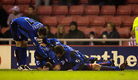 Photo: Jed Wee.<br /> Sunderland v Middlesbrough. Barclays Premiership. 31/01/2006.<br /> <br /> Middlesbrough celebrate with the prone form of goalscorer Stuart Parnaby.