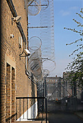 Security measurres around the outside of one of the wings. HMP Wandsworth, London, United Kingdom