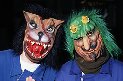 Carnival in Toledo with people wearing masks,