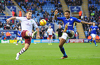Burnley's Sam Vokes chips the ball over Leicester City's Liam Moore <br /> <br /> Photo by Chris Vaughan/CameraSport<br /> <br /> Football - The Football League Sky Bet Championship - Leicester City v Burnley - Saturday 14th December 2013 - King Power Stadium - Leicester<br /> <br /> © CameraSport - 43 Linden Ave. Countesthorpe. Leicester. England. LE8 5PG - Tel: +44 (0) 116 277 4147 - admin@camerasport.com - www.camerasport.com