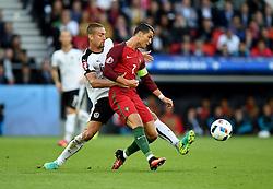 Cristiano Ronaldo of Portugal battles for the ball with  Stefan Ilsanker of Austria  - Mandatory by-line: Joe Meredith/JMP - 18/06/2016 - FOOTBALL - Parc des Princes - Paris, France - Portugal v Austria - UEFA European Championship Group F