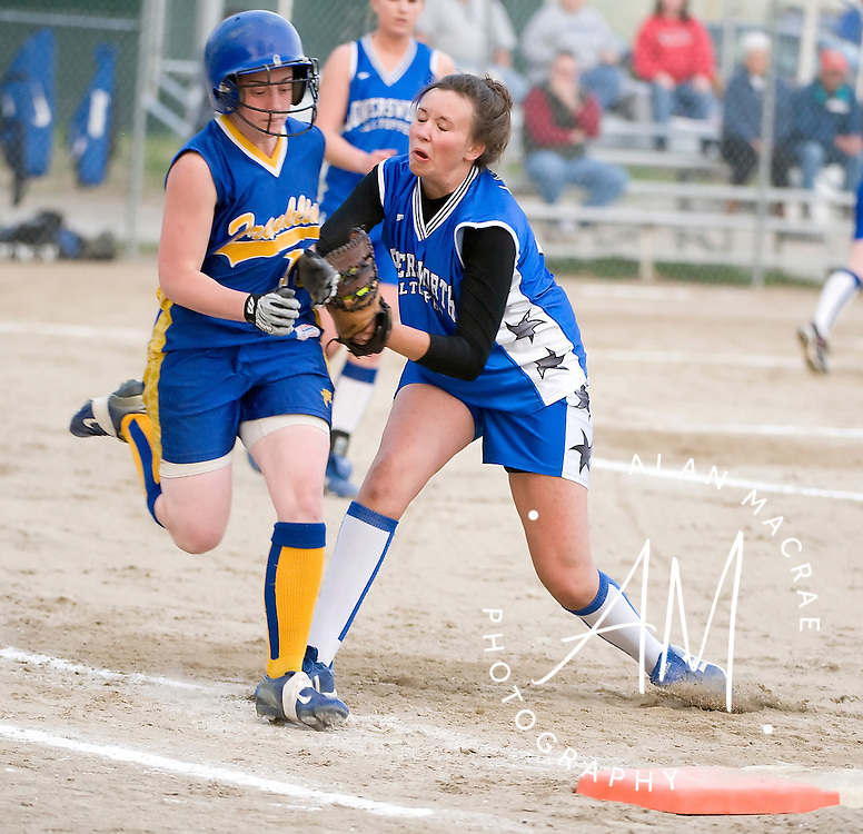 Somersworth first baseman Rachel Lausberg tags Franklin's Kendra Emond during last night's match under the lights at Franklin's Odell Park.  (Alan MacRae/for the Citizen)