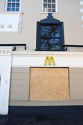 McDonalds closed during the Coronavirus lock down - boarded up for security reasons. Norwich UK March 2020