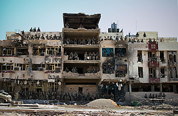 At the conclusion of the Battle of Najaf, all of the Marines of Charlie Company 1st BN 4th Marines gather in the windows and doors of a quartet of hotels they have held and and fought from for three days against Moqtada al-Sadr and his Mehdi Army  on August 27, 2004.<br />
