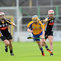9 July 2011; Naomi Carroll, Clare, in action against Edel Maher,11, and Aoife Neary, Kilkenny. All Ireland Senior Camogie Championship in association with RTE Sport, Kilkenny v Clare, Nowlan Park, Kilkenny. Picture credit: Matt Browne / SPORTSFILE *** NO REPRODUCTION FEE ***