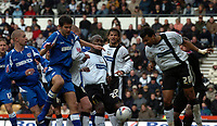 Photo: Ian Hebden.<br />Derby County v Millwall. Coca Cola Championship. 08/04/2006.<br />Millwalls David Phillips (L) challenges with Derbys Darren Moore (C) as Derbys Kevin Poole heads away.