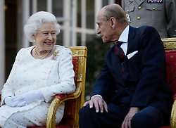 Queen Elizabeth II and the Duke of Edinburgh attend a garden party in Paris, hosted by Sir Peter Ricketts, Britain's Ambassador to France ahead of marking the 70th anniversary of the D-Day landings during World War II.