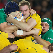 Pat McCabe, Australia, is tackled during the Australia V Ireland Pool C match during the IRB Rugby World Cup tournament. Eden Park, Auckland, New Zealand, 17th September 2011. Photo Tim Clayton..