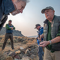 Dr. Robert Bettinger shows early Native American artifacts to fellow archaeologists at a Native American settlement that was used around AD 750.  L to R: Robert Rober, Luke Barton , Micah Hale. & Bettinger.