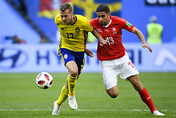 July 3, 2018 - Saint Petersburg, Russia - Viktor Claesson of Sweden duels with Ricardo Rodriguez of Switzerland during the 2018 FIFA World Cup Round of 16 match between Sweden and Switzerland at Sankt Petersburg Stadium in Sankt Petersburg, Russia on July 3, 2018  (Credit Image: © Andrew Surma/NurPhoto via ZUMA Press)